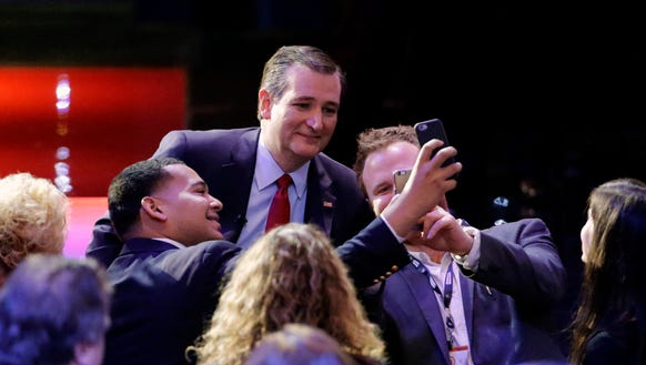 Ted Cruz takes a photo with members of the audience