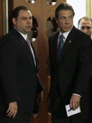 Joseph Percoco, left, enters the New York state Capitol's