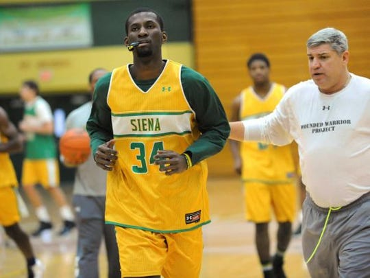 Siena's Imoh Silas, center, with coach Jimmy Patsos, right, during basketball practice on Tuesday, Nov. 26, 2013, at Siena College, N.Y.