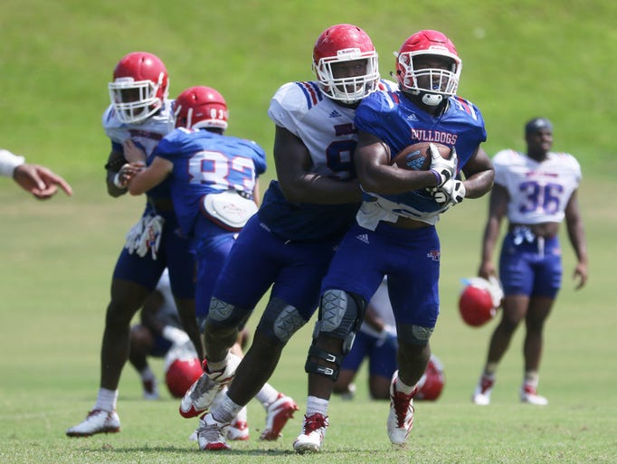 Bulldogs' defensive end Immanuel Turner tries to prevent