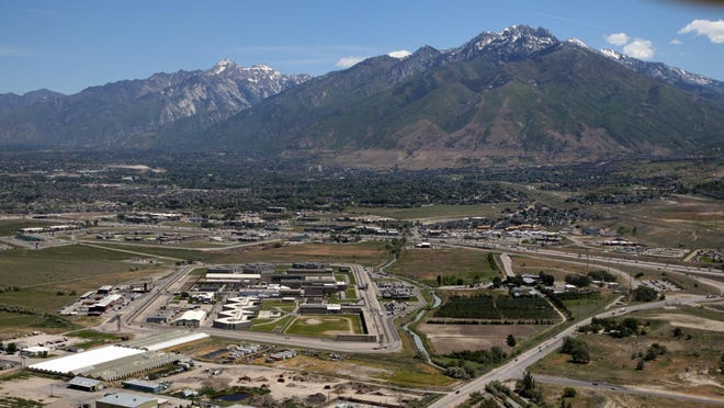 This June 6, 2013, file photo, shows the Utah State Prison, left foreground, in Draper. State officials have studied for years if and where they'll rebuild Utah's main state prison.