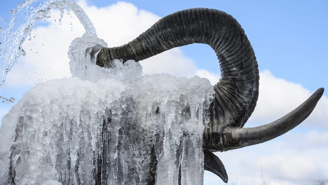 Icicles hang from a frozen elephant fountain on Feb. 27, 2018 in Colchester, United Kingdom.
