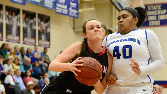Pisgah senior Maddie Webb, left, has signed to play college basketball for Mars Hill.