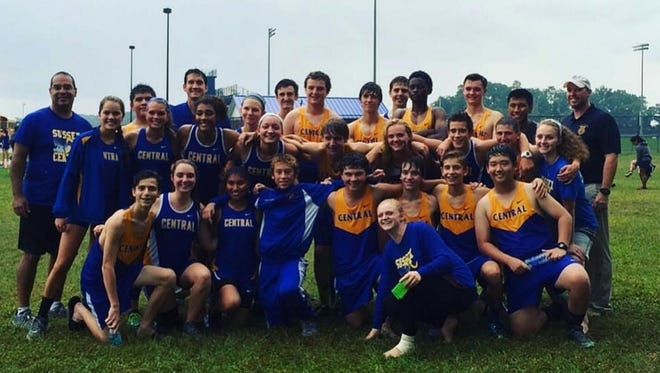 The Sussex Central cross country team celebrates its victory against Caesar Rodney on Wednesday.
