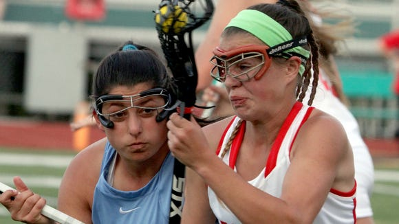 North Rockland's Kerri Gutenberger is defended by Suffern's  Allison Iodice during the Section 1 Class A girls lacrosse championship at Yorktown High School May 24, 2017. North Rockland defeated Suffern 14-13.