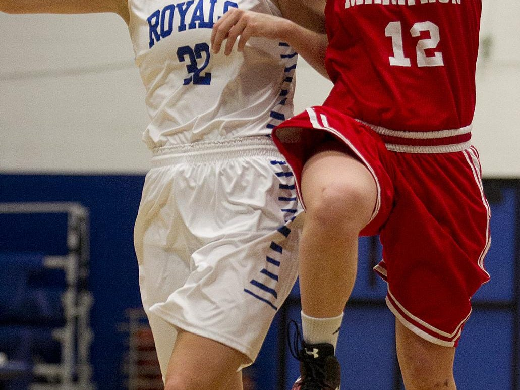 Marathon's Jayci Blume, right, drives past Assumption's Gena Grundhoffer during the first half of the Marawood Conference girls basketball game at Assumption High School in Wisconsin Rapids, Tuesday, Dec. 1, 2015.