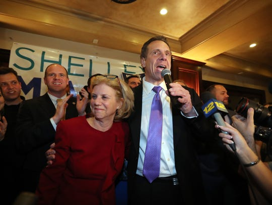 Shelley Mayer is congratulated by Gov. Andrew Cuomo