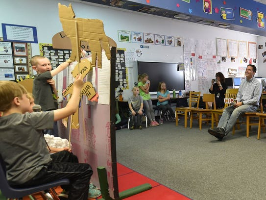 Katie Grooter's second-grade students present a puppet