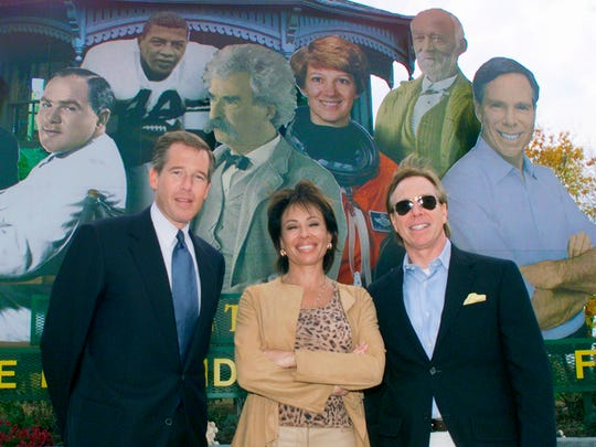 NBC news anchor Brian Williams, former Westchester County district attorney Jeanine Pirro and fashion designer Tommy Hilfiger stand in front of Elmira's welcome sign in 2005.