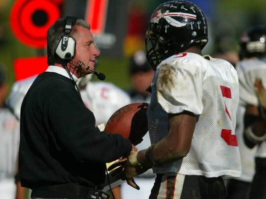 Keyport head coach Mike Ciccotelli is handed the ball