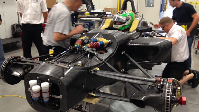 Driver Conor Daly gets fitted for the new Indy Lights car at Dallara's facility in Speedway.
