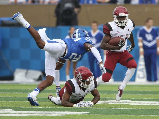 Sep 17, 2016; Lexington, KY, USA; New Mexico State Aggies running back Jason Huntley (14) runs the ball against Kentucky Wildcats cornerback Chris Westry (21) in the first quarter at Commonwealth Stadium.