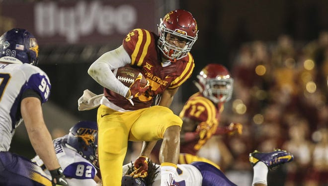 Iowa State wide receiver Allen Lazard (5) evades UNI defenders on a punt return during the first half of their game Saturday Sept. 5, 2015, at Jack Trice Stadium in Ames, Iowa.