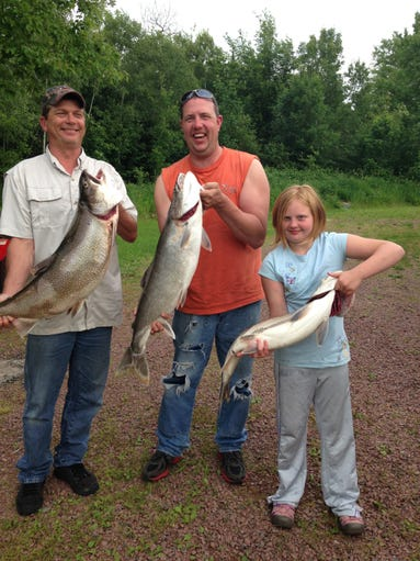 Samantha Soback, 10, and her dad Chad Soback and uncle