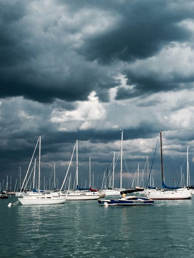 Storm clouds gather over the lakefront in downtown