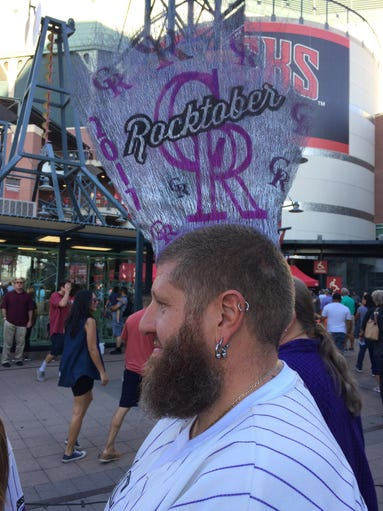 Colorado Rockies fan Josh Pugh, of Aurora, CO., is