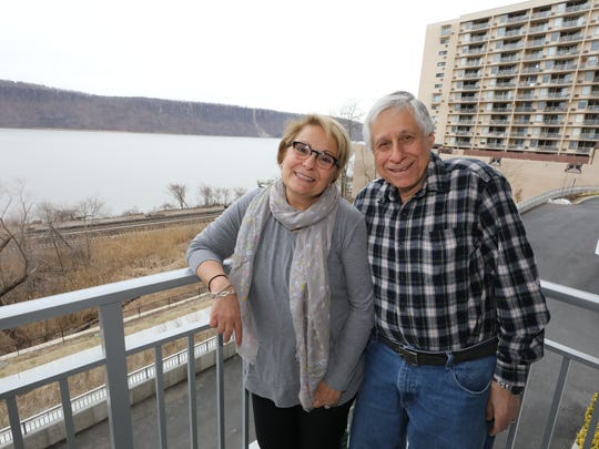 Constance and Ted Canaras, pictured on their terrace at their residence, River Tides at Greystone in Yonkers.