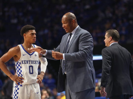 """Kentucky assistant coach Kenny Payne talks with Quade Green in the second half Friday night at Rupp Arena. The Wildcats won 78-61 after a sluggish start early in the first half. """"I would tell our fans, just enjoy this, because I'm the one dying,"""" said Calipari afterwards."""