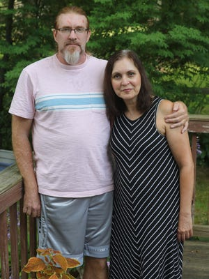 Mike Tosko and Angela Bilia, a married couple from Stow, are both on the list of University of Akron faculty to be laid off.