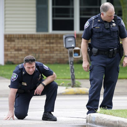 Appleton police officers look for evidence Saturday