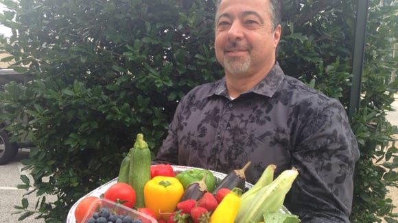 Anthony Iannone, owner of Anthony's Creative Italian Cuisine in Haddon Heights, shows off the types of fresh produce that SJ Hot Chefs will use during Farm to Fork Week.