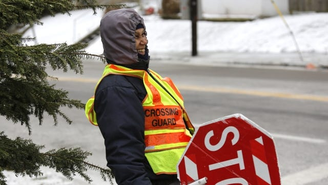 Crossing guard Darlene Etter stands waiting for students after an extra long Christmas break, which included two snow days earlier this week.