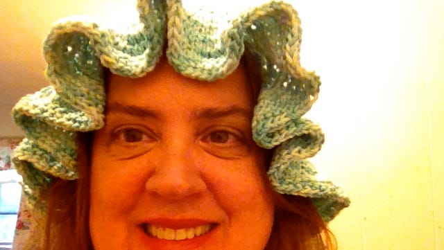 This was the most flattering photo I could find of me wearing the hat with a ruffled brim.