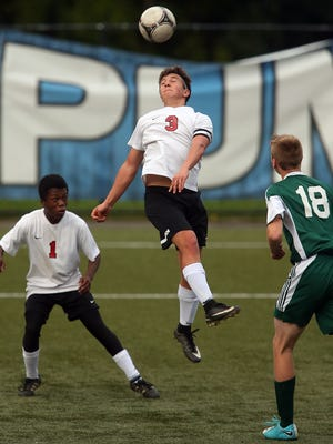 Crosspoint's Aydan Laurion (3) connects with a header durign the second half of their game against Evergreen Lutheran at Gordon Field on Wednesday, October 25, 2017.