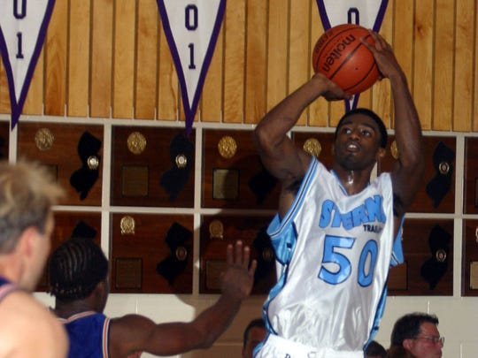 Neptune's Taquan Dean takes the shot  during a Jersey