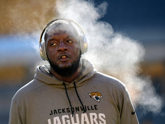 Jacksonville Jaguars offensive tackle Cam Robinson warms up before an NFL divisional football AFC playoff game against the Pittsburgh Steelers in Pittsburgh, Sunday, Jan. 14, 2018. (AP Photo/Don Wright)