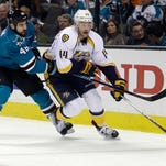 The Nashville Predators' Mattias Ekholm (14) works against the San Jose Sharks' Roman Polak (46) during the second period of Game 1 in the Western Conference semifinals on April 29, 2016.