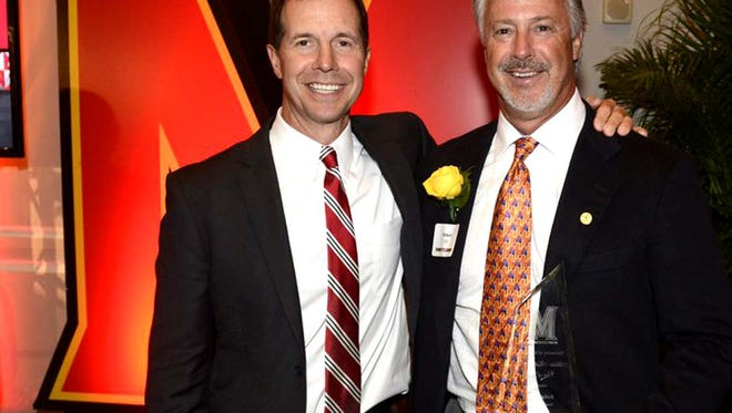 Bob Ott (right) with Maryland coach John Tillman during his induction into Athletics Hall of Fame.