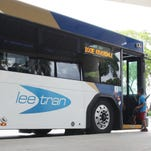 Passengers board a LeeTran bus at the station in downtown Fort Myers.