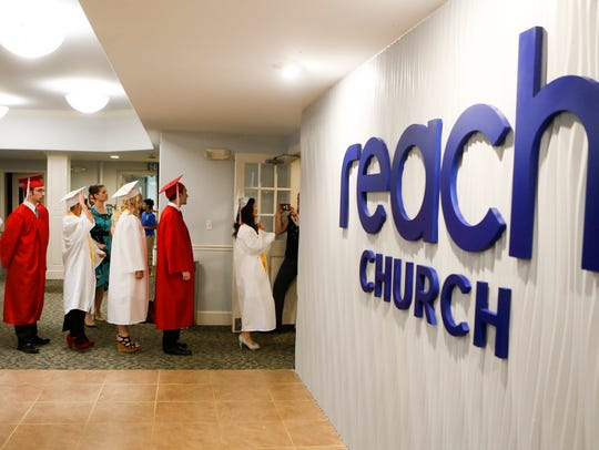 The class of graduates files into the sanctuary as Red Lion Christian Academy hosts commencement for the 35 graduates of the class of 2017 at Reach Church.