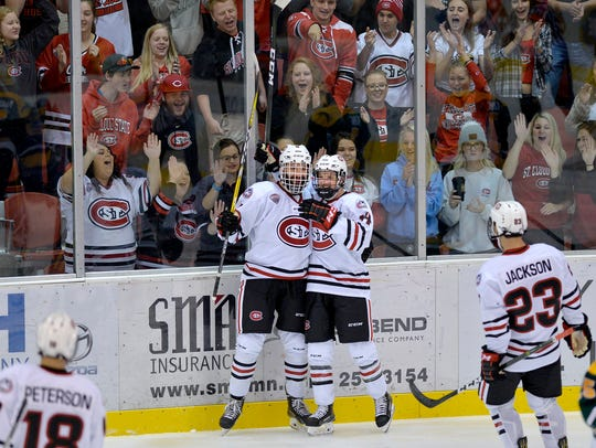 St. Cloud State's Patrick Newell (14) celebrates a