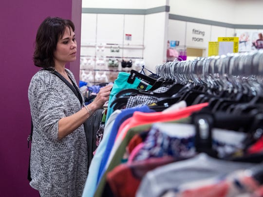 Sarah Tuttle, who served in the Navy, shops for appropriate interview clothing at J.C. Penney at La Palmera mall through a partnership between the store and Goodwill Industries of South Texas on Thursday, March 15, 2018.