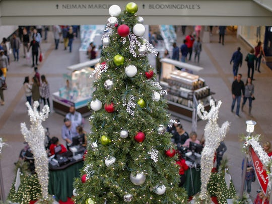 Bargain hunters seek deals during holiday shopping at the Lenox Square Mall in Atlanta.