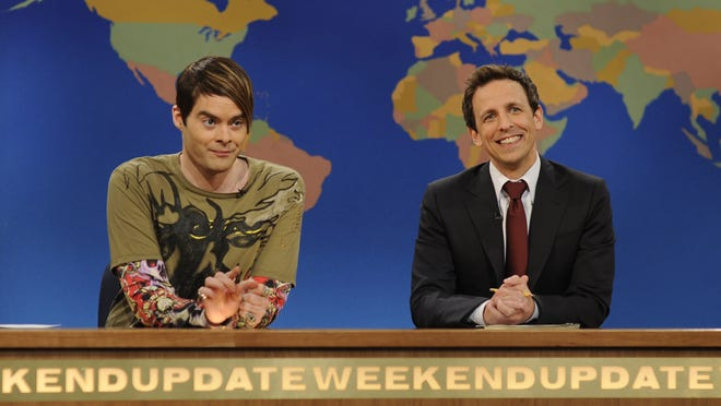 """ORG XMIT: NYET366 This image released by NBC shows Bill Hader, portraying the character Stefon, left and Seth Meyers during a skit from """"Saturday Night Live.""""  Hader was nominated for an Emmy award Thursday, July 19, 2012 for outstanding supporting actor in a comedy series for his various roles on """"SNL."""" Fellow castmate Kristen Wiig was also nominated for an Emmy award for her various roles on """"Saturday Night Live."""" The 64th annual Primetime Emmy Awards will be presented Sept. 23 at the Nokia Theatre in Los Angeles, hosted by Jimmy Kimmel and airing live on ABC. (AP Photo/NBC,Dana Edelson)"""