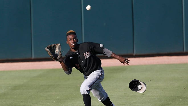 New Mexico State's Daniel Johnson catches a fly ball during the Western Athletic Conference Tournament Saturday afternoon at Hohokam Stadium in Mesa, Arizona.