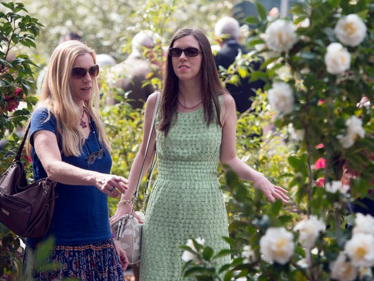 Dee Dee, left, and Jessica Comeau take a tour of the Camellia Garden at the University of West Florida in this file photo. A variety of camellia plants will be available for purchase at the UWF Camellia Garden Tours and Plant Sale on Saturday.