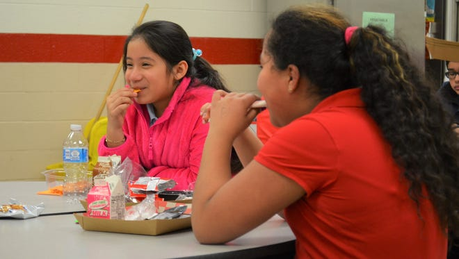 Yareli Hernandez munches on a snack during the meal time at RightFit. Yareli is one of the 550 kids enrolled in the after-school program at IPS Schools 96, 46 and 56 and Holy Angels Catholic.