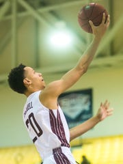 UMES guard Dontate Caldwell (20) goes for a lay up