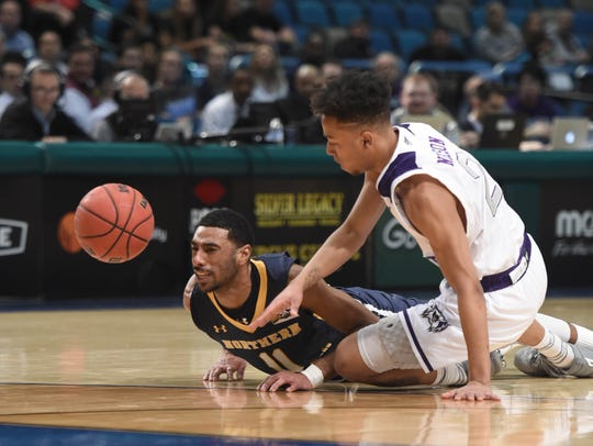 Northern Colorado's Andre Spight trips over Weber State's