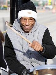 Keith Hudson plays his drum set across the street from Lambeau Field on Dec. 3.