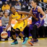 Phoenix guard Diana Taurasi, right, guards Los Angeles forward Alana Beard during Game 1 of the 2013 WNBA Western Conference semifinals.