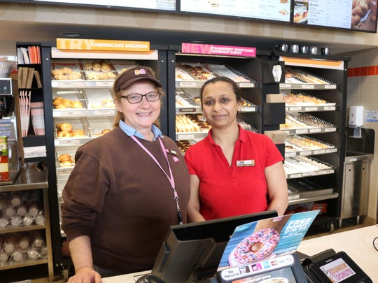 Managers Becky Laskos (left) and Sejal Patel are two of the friendly faces you can see on your next doughnut run.