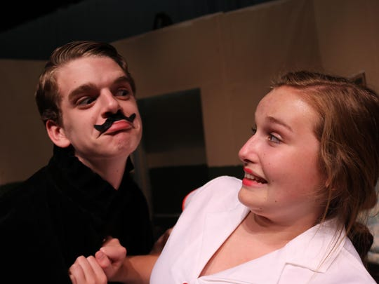 """Bertram Oleander (Jeff Bell) tries to charm his way into the arms of Constant Hope (Bridget Smith) in """"Egad, What a Cad!"""" part of Harrison High's upcoming double-comedy production."""