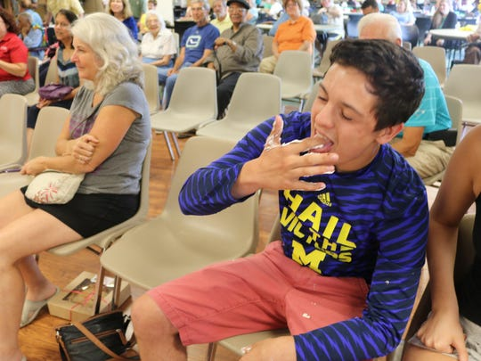 Dylan Neufeld enjoys the taste of victory – and whipped cream – after nailing his dad, Jamie, with a pie.