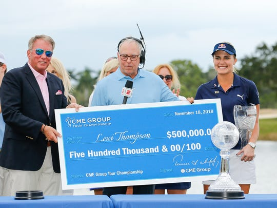 CME Group Chairman and CEO Terry Duffy presents Lexi Thompson with the CME Group Tour Championship check after the final round at Tiburon Golf Club on November 18, 2018 in Naples, Florida.  (Photo by Michael Reaves/Getty Images)