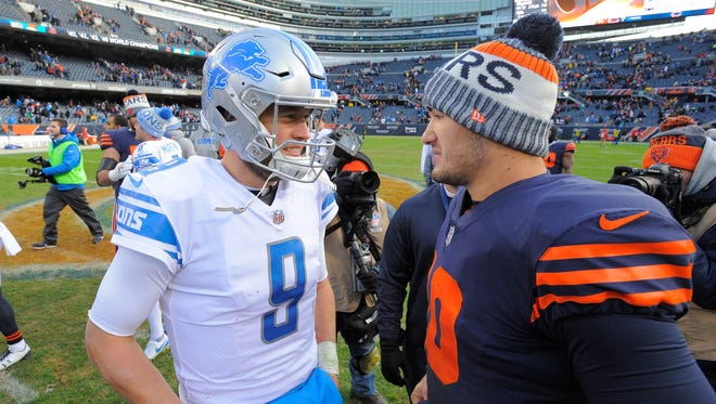 Lions quarterback Matthew Stafford and rookie Bears quarterback Mitchell Trubisky meet on the field after the 27-24 Detroit victory over Chicago.